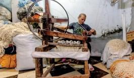 Man spinning thread.