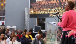 Woman speaking at podium to crowd at 22 On Sloane in Johannesburg, South Africa.